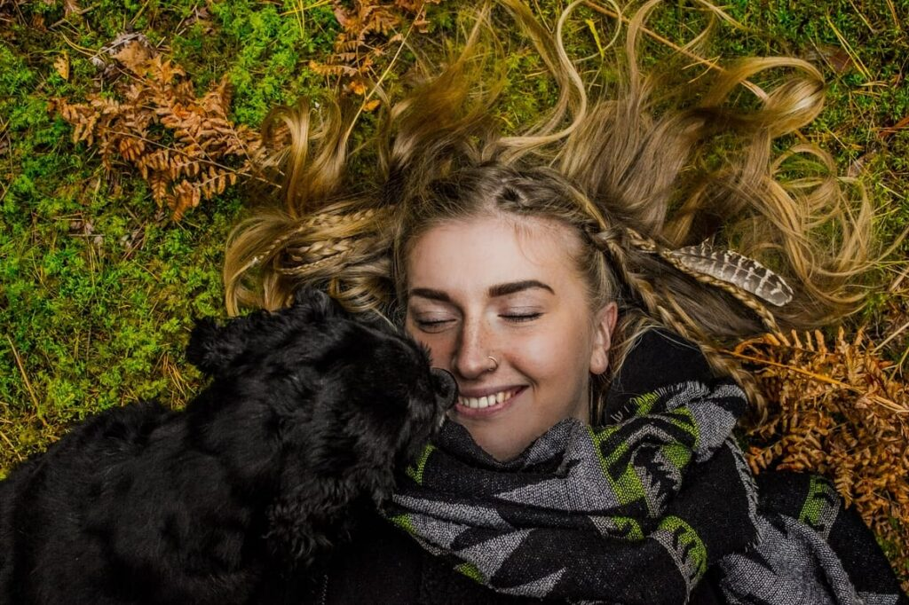 Dog cuddling a woman