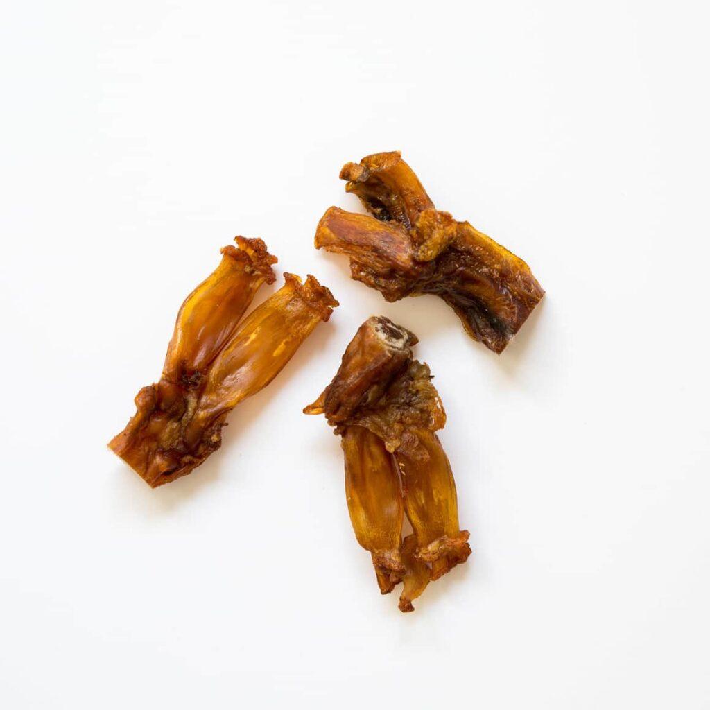 Three beef tendon dog chews